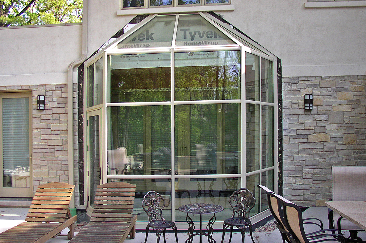 Straight eave lean-to sunroom with angled gable ends.