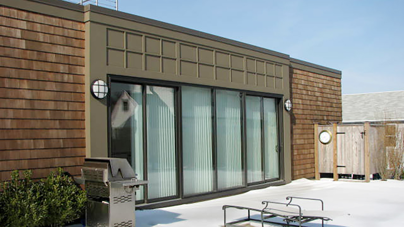 Six curtain wall systems, three folding glass walls, and six sliding glass doors all in Bronze frame finish and utilizing 272 glass.