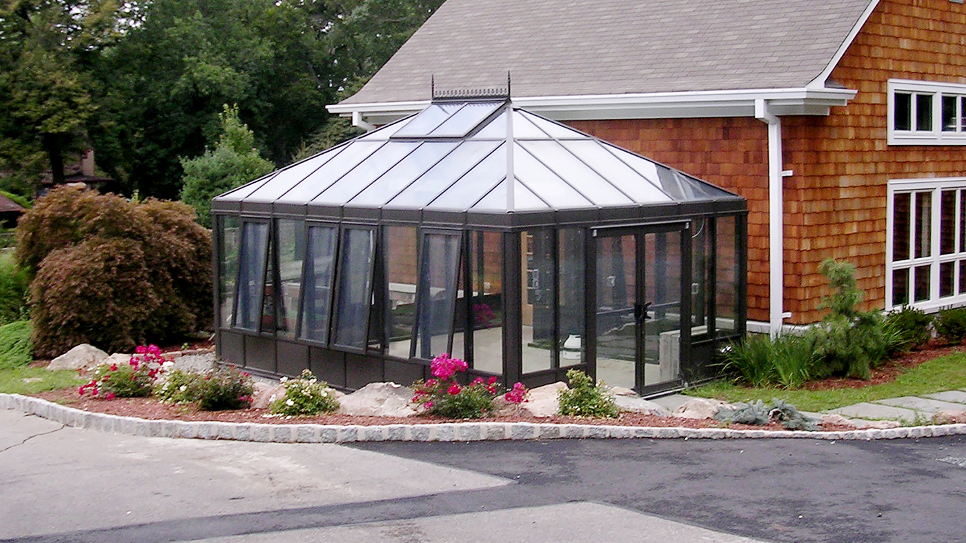 Straight Eave Double pitch conservatory with two hip ends and walkway to main building