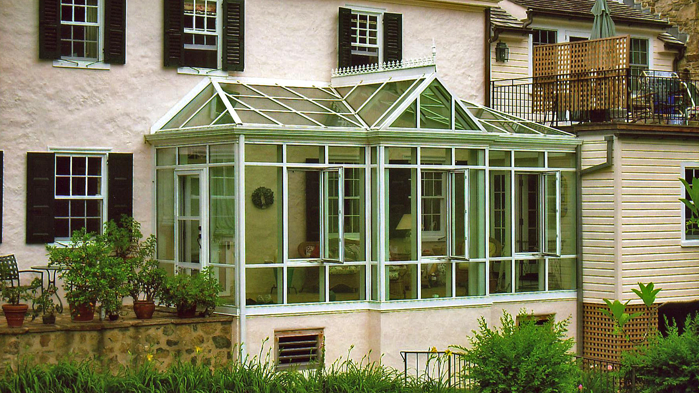 Straight eave lean-to conservatory with two irregular hip ends, and one straight eave double pitch dormer with one gable end.