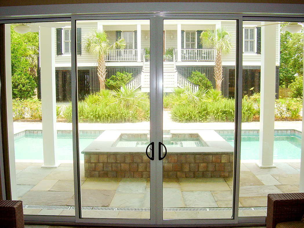 Mulitpocketed sliding glass doors on a pool house