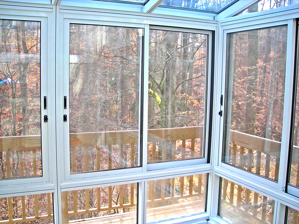 Straight eave lean-to sunroom with sliding patio door.