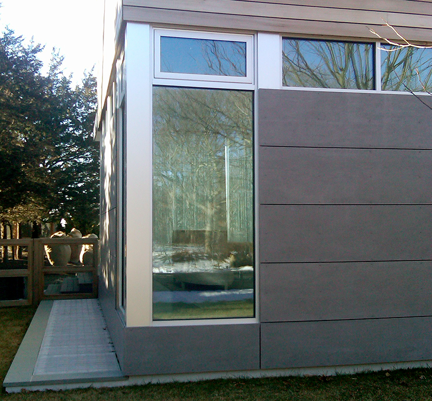 One single door folding wall system, 3 panels fold left; framing color is clear anodized, mulled window system, and pivot door.