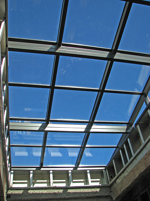 Straight eave lean-to skylight.