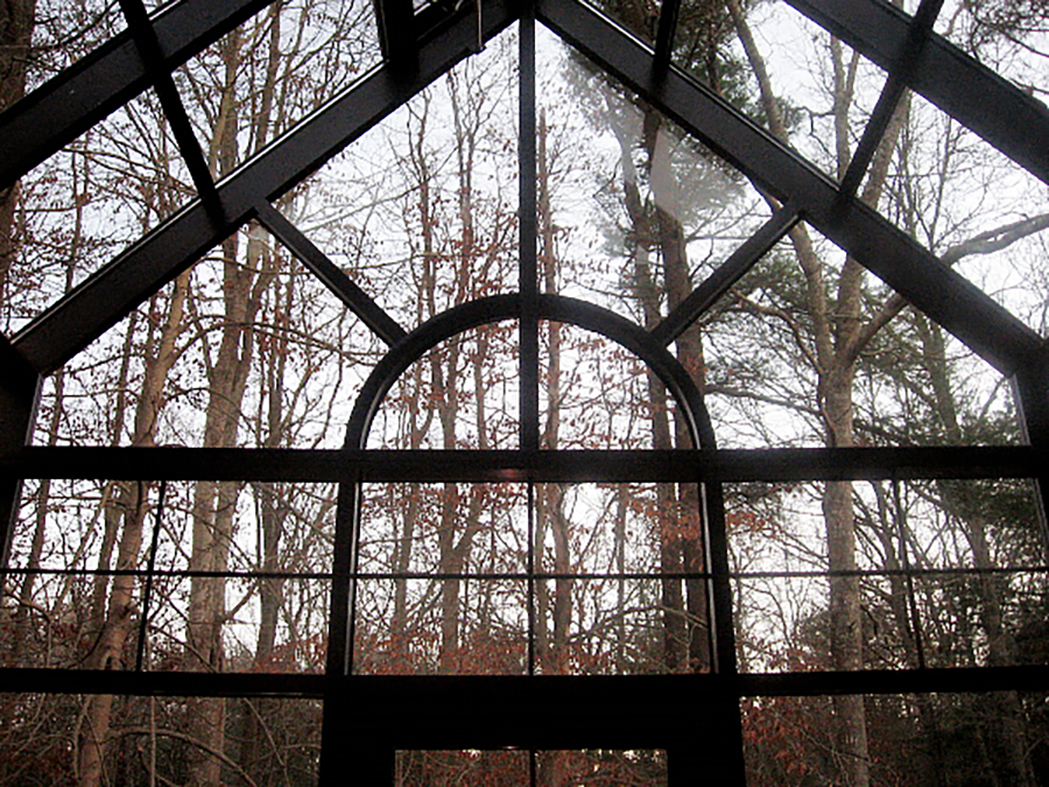 Straight eave double pitch greenhouse with a true divided Palladian arch and interior muntins in the transom.