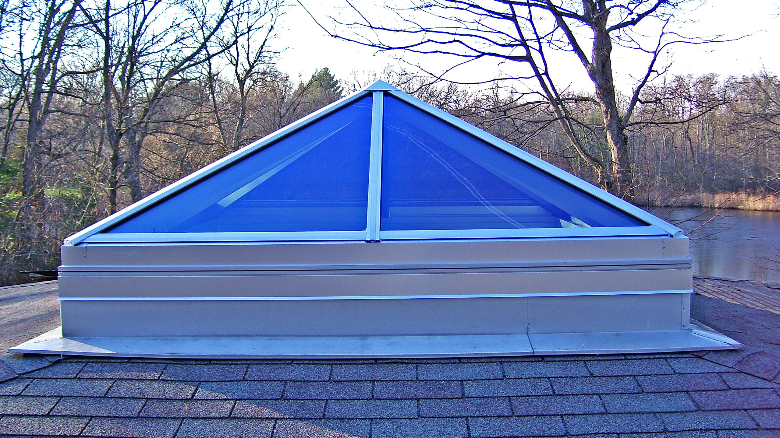 Pyramid skylight and straight eave double pitch skylights.