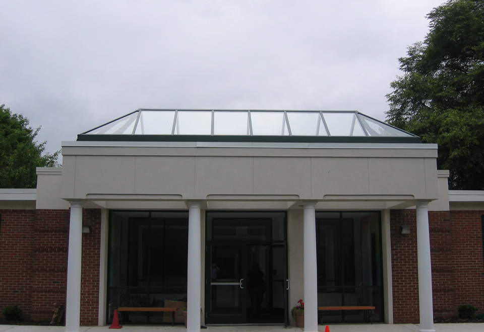Straight eave double pitch skylight canopy with two hip ends. Framing is hartford green duracron and is set up for 1/4 inches glazing.