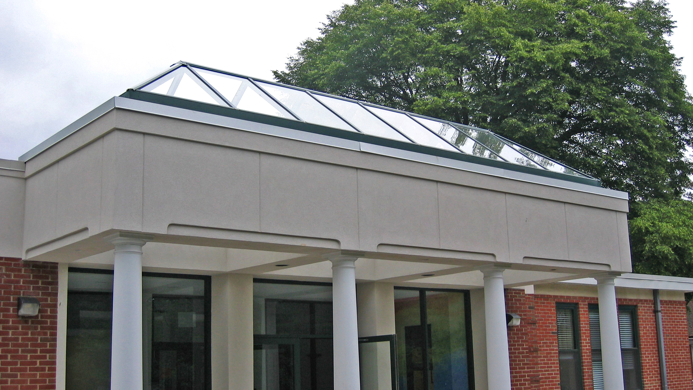 Straight eave double pitch skylight canopy.