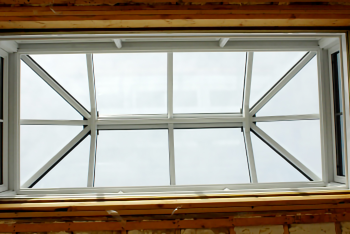 Straight eave double pitch skylight with two hip ends.