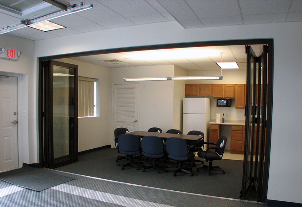Restoration folding glass wall system used in an office application