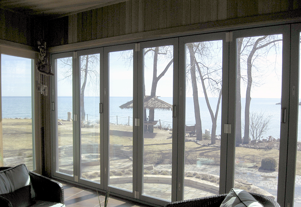 Two folding door systems with all wall configuration, panels fold in, standard sill.