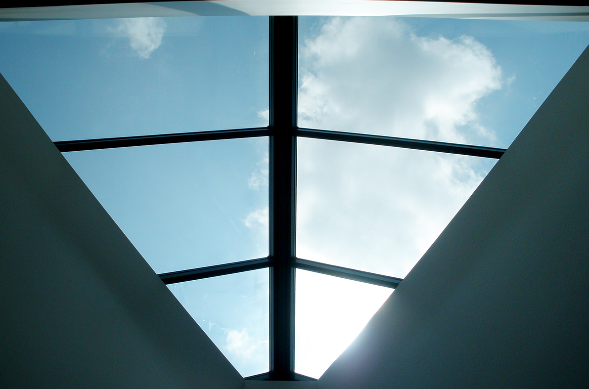 Straight eave double pitch ridge mounted fixed skylight