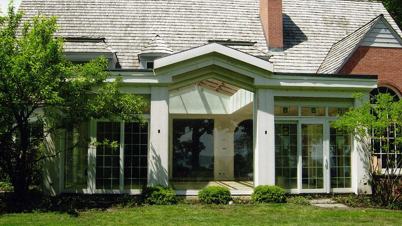 Irregular gable style curtain wall with outswing doors.