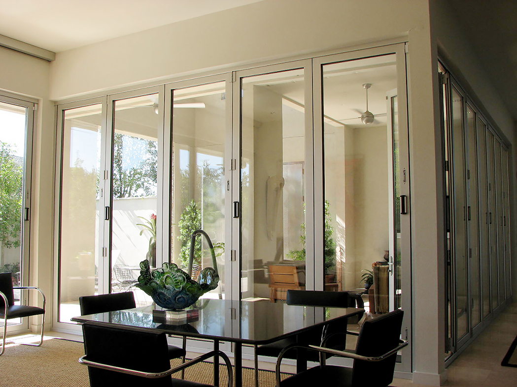Three folding glass wall systems: two all wall systems, one single door system.