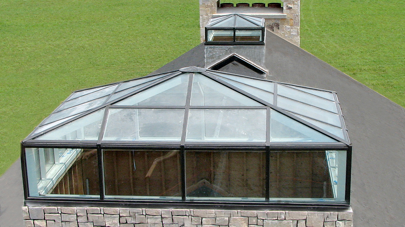 Three pyramid skylights with transoms