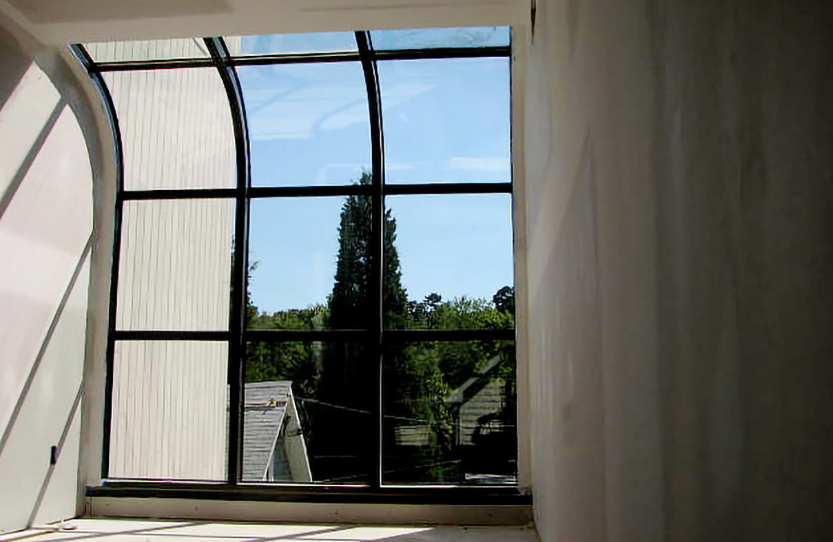Curved eave lean-to skylight