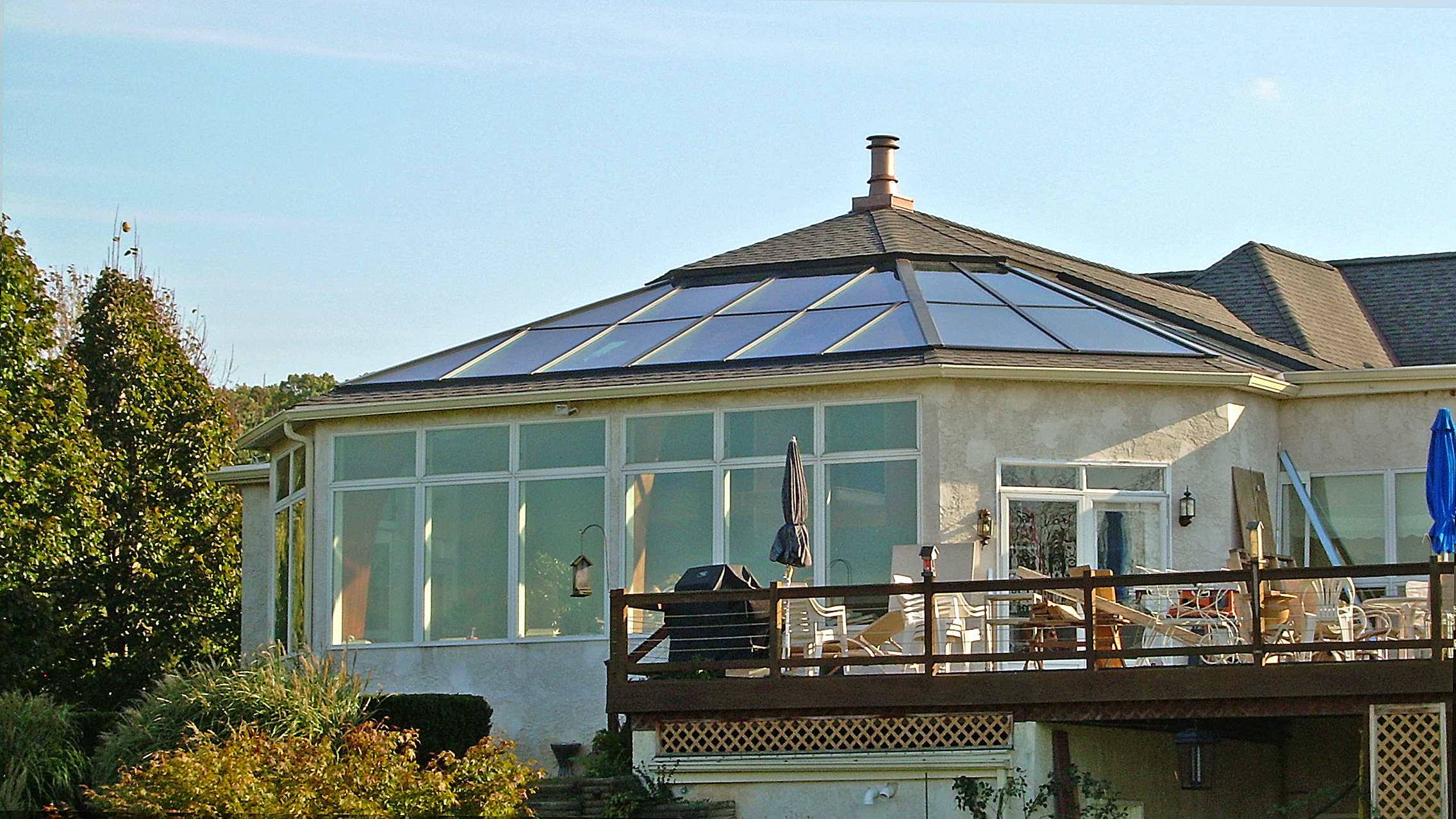 Irregular straight eave lean-to skylight with four hipped corners.