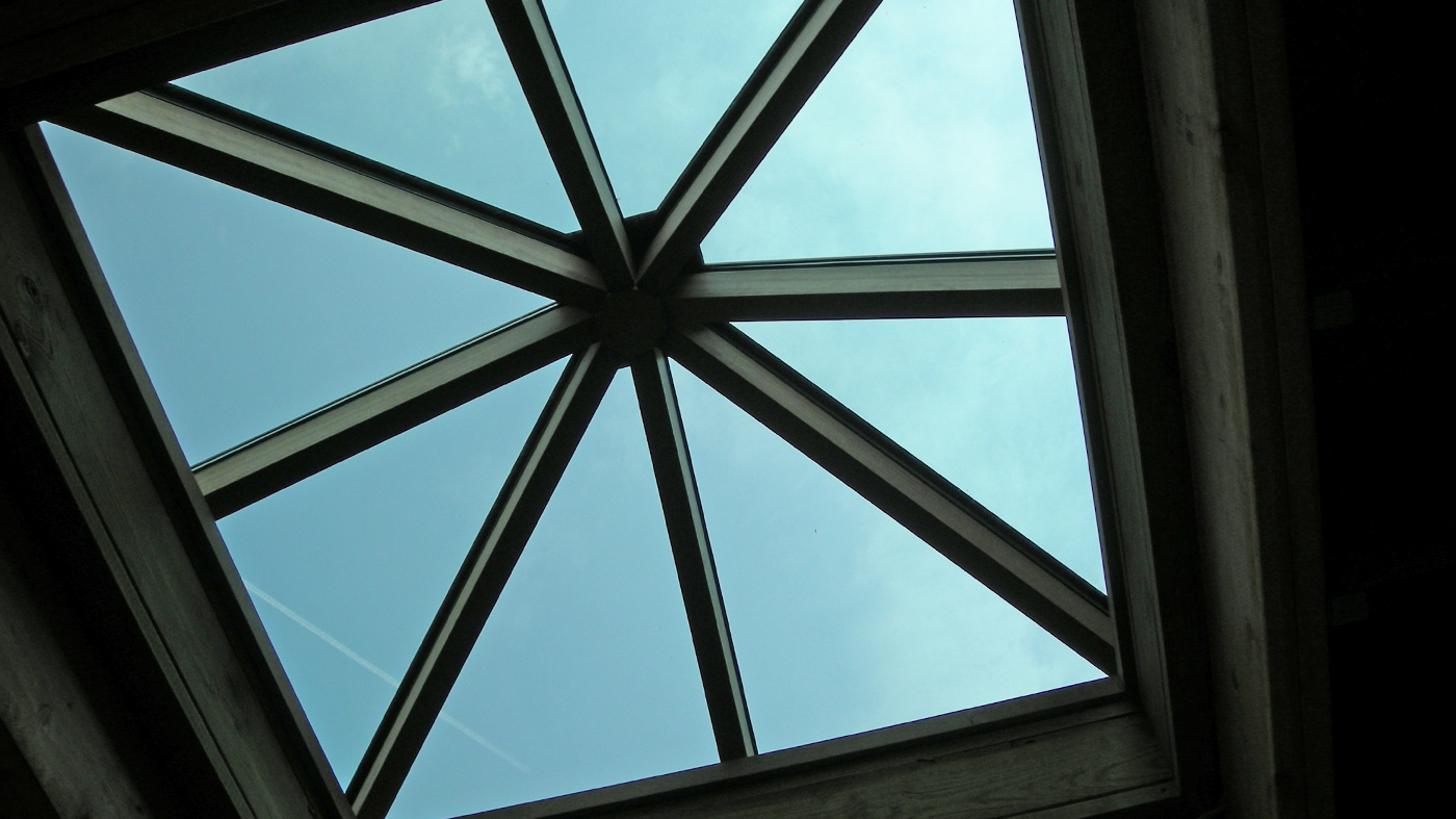 Curb-mounted pyramid skylight.