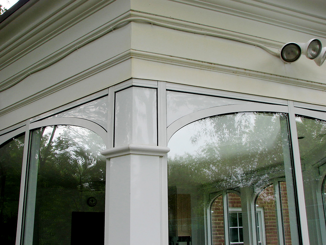 Vertical curtain wall system constructed with 4 1/2 inch aluminum system, includes columns with decorative faux covers.