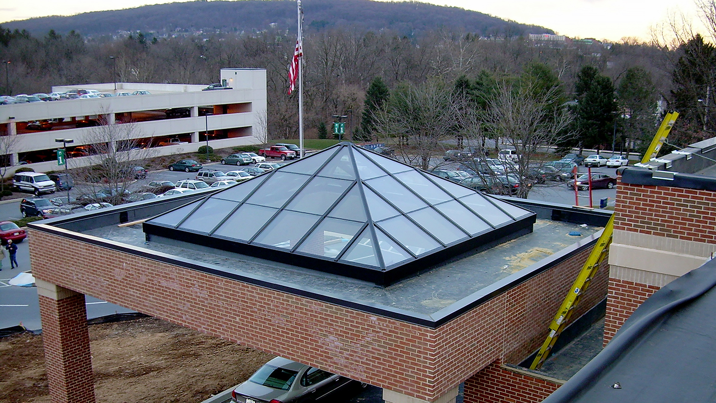 Pyramid skylight acting as canopy. Framing system is 3x6 aluminum system in Dark Bronze Anodized frame finish. Glazing is Sol-I-Guard 272.