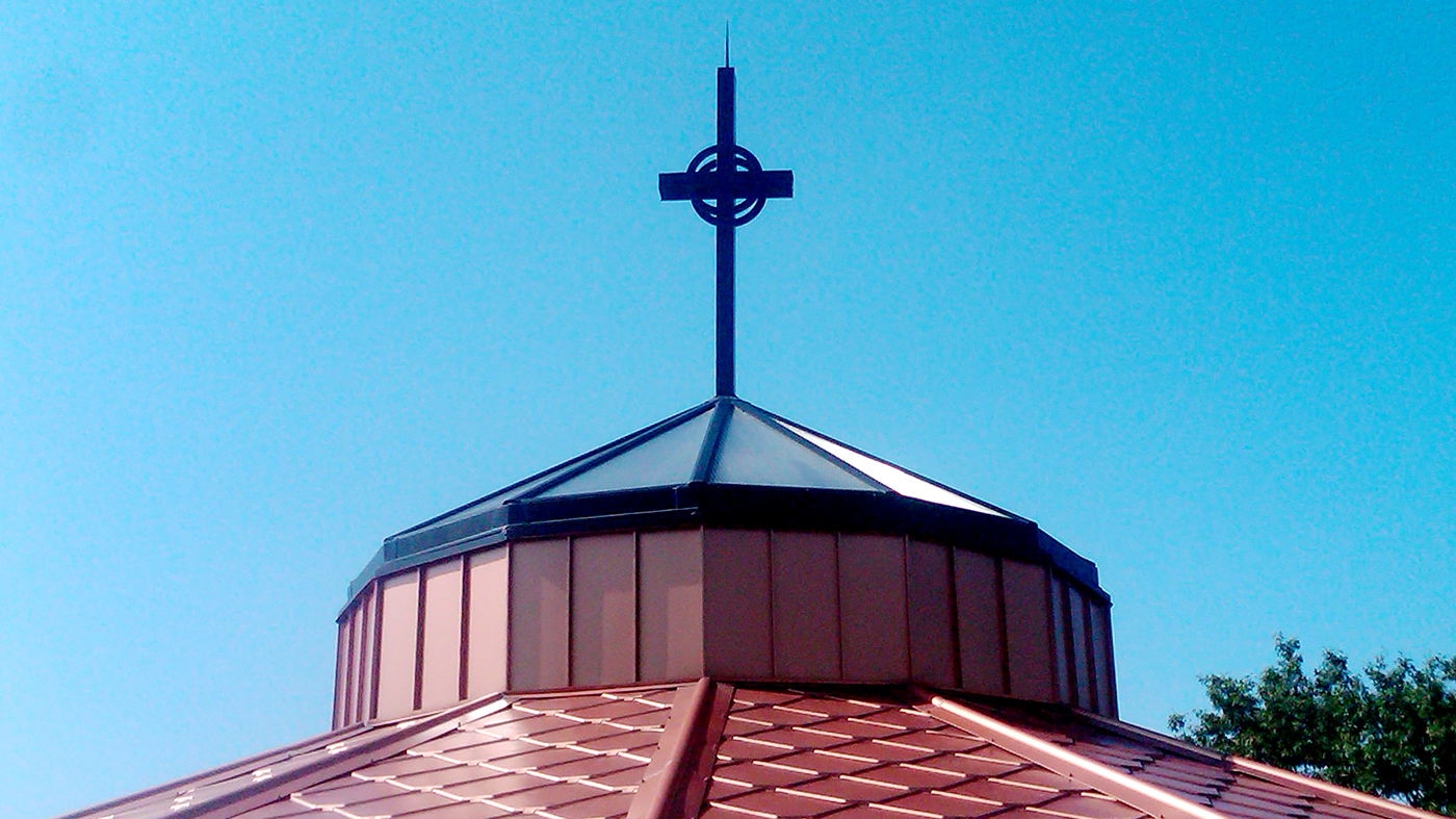 Polygonal skylight with polycarbonate infill and custom-designed cross finial