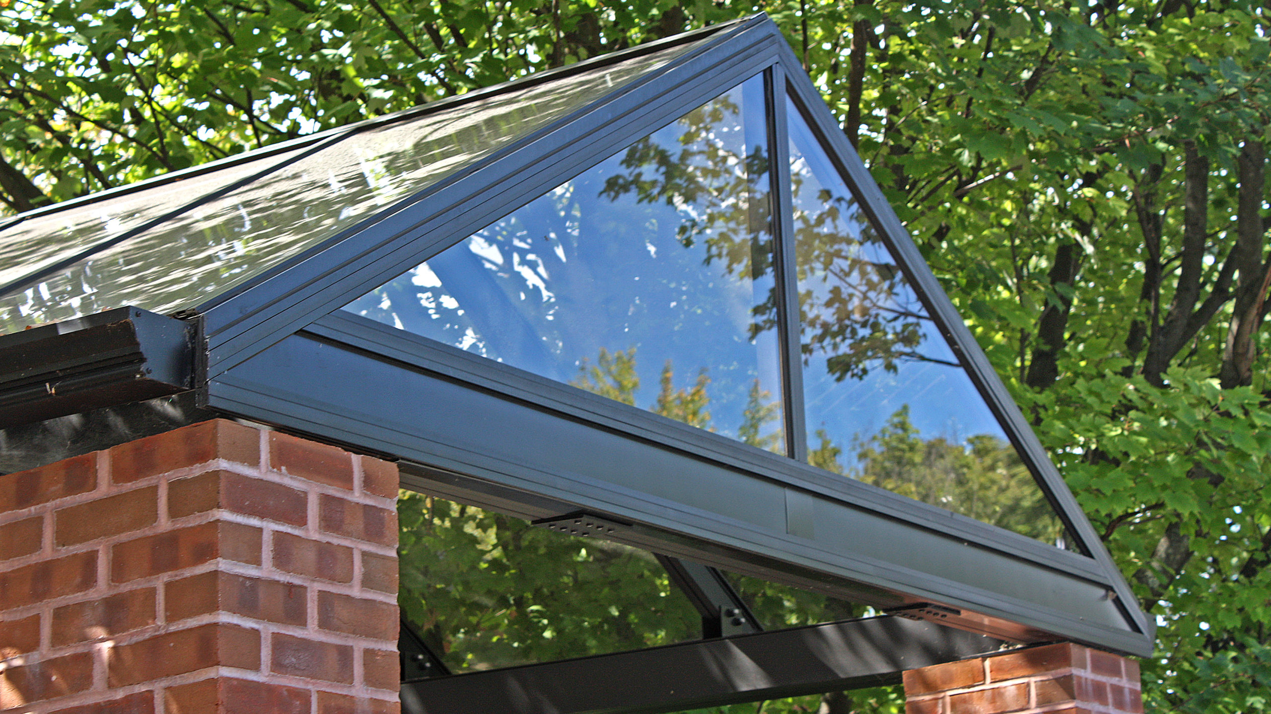 Straight eave double pitch canopy.
