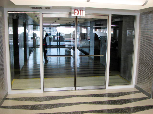 Commercial Curtain Wall and french door featuring entryway / vestibule.