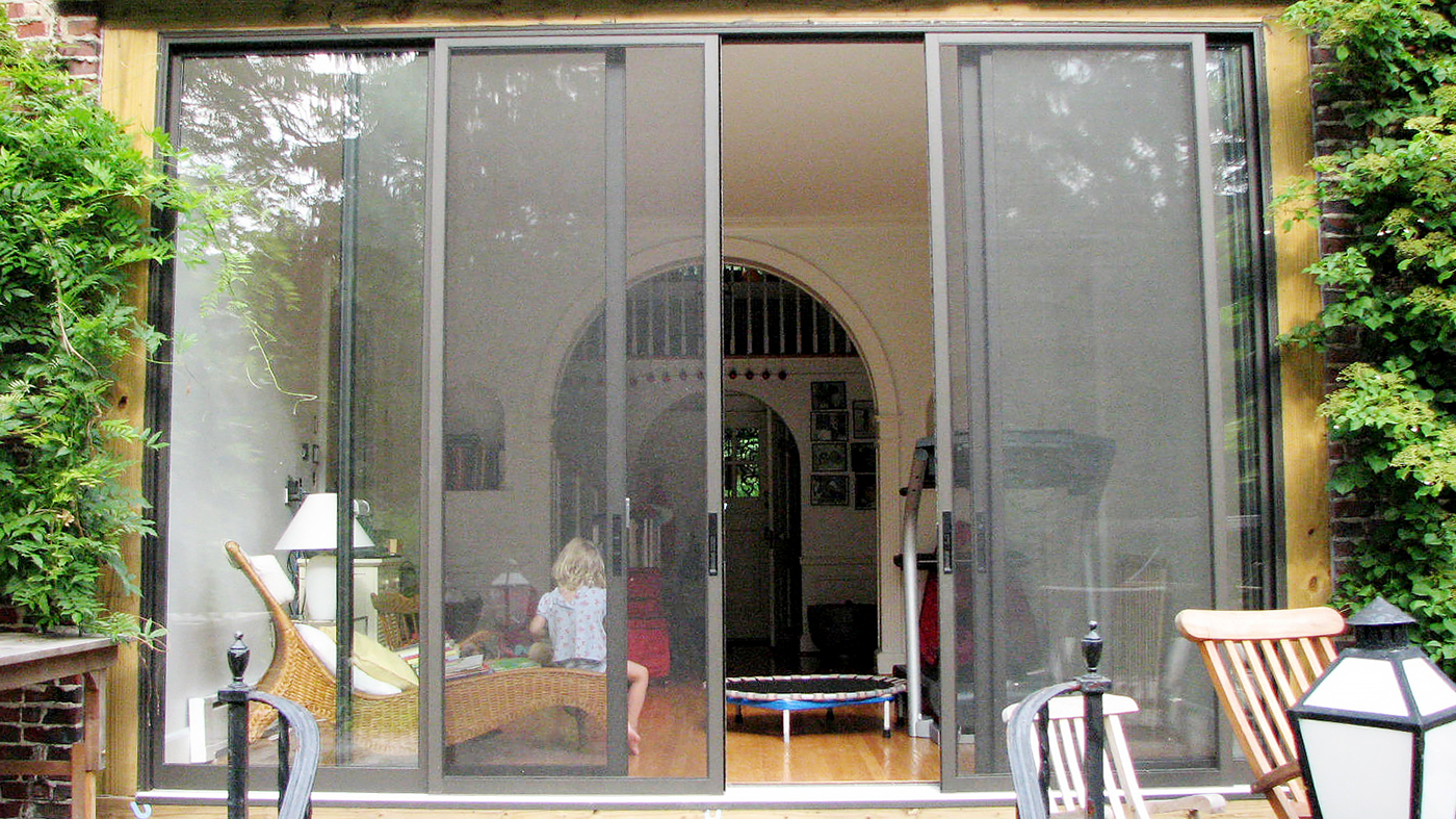 Two-bay sliding, stacking screen system with Bronze interior and exterior frame finish