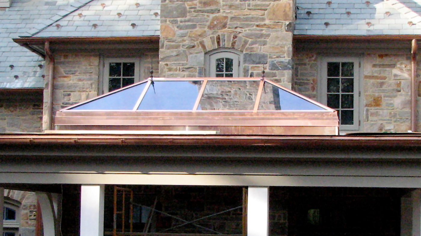 Straight eave double pitch hip end copper clad skylight