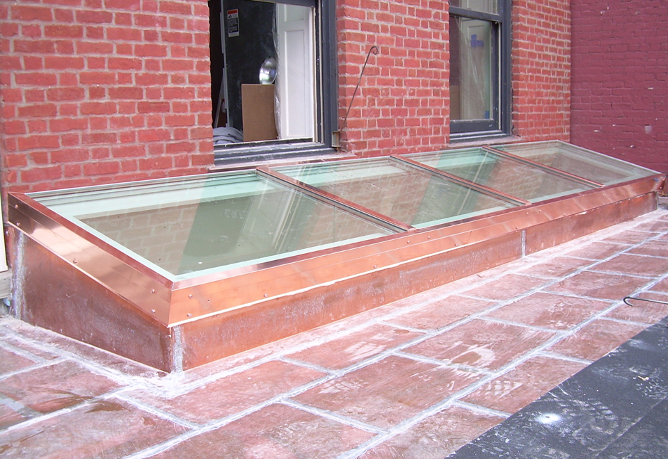 Single slope, curb mount skylight with exterior copper cladding. The skylight was shipped pre-assembled to the job site.