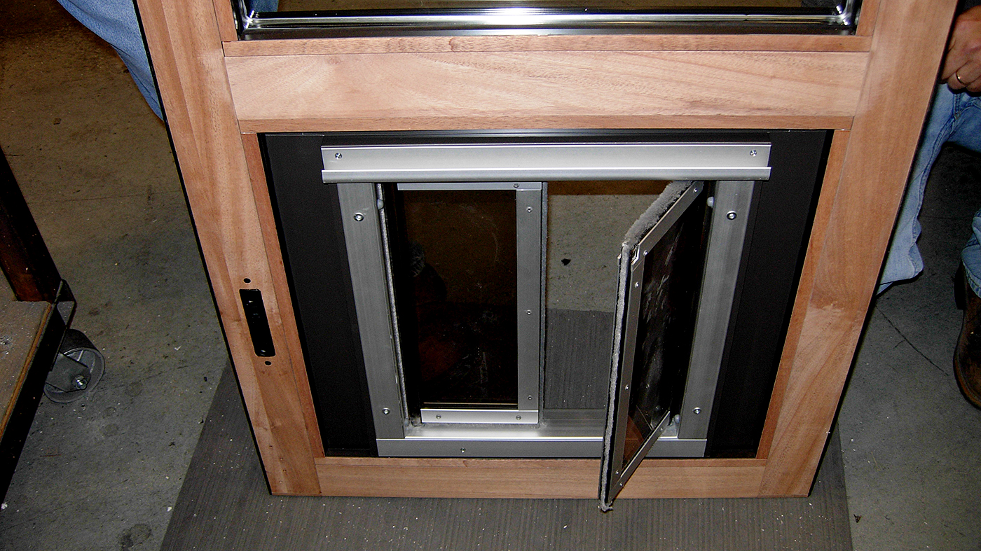 Three sets of bifold doors with one panel incorporating a Plexidor dog door