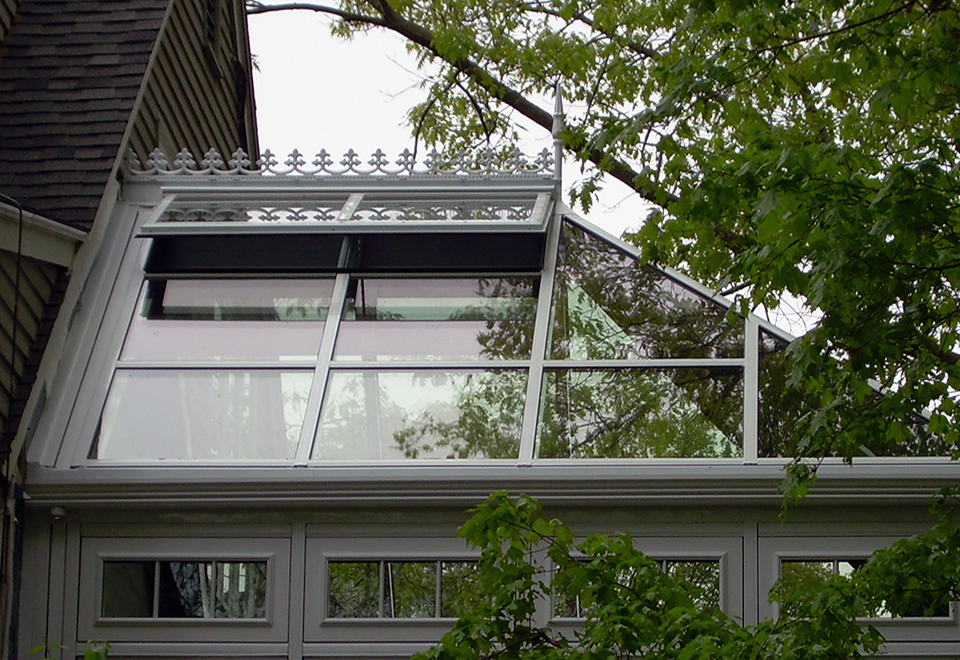Straight eave double pitch conservatory with one hip end. Decorative accessories include: ridge cresting, finial, SDL grids in traditional pattern, transoms, fixed windows and ogee capping.