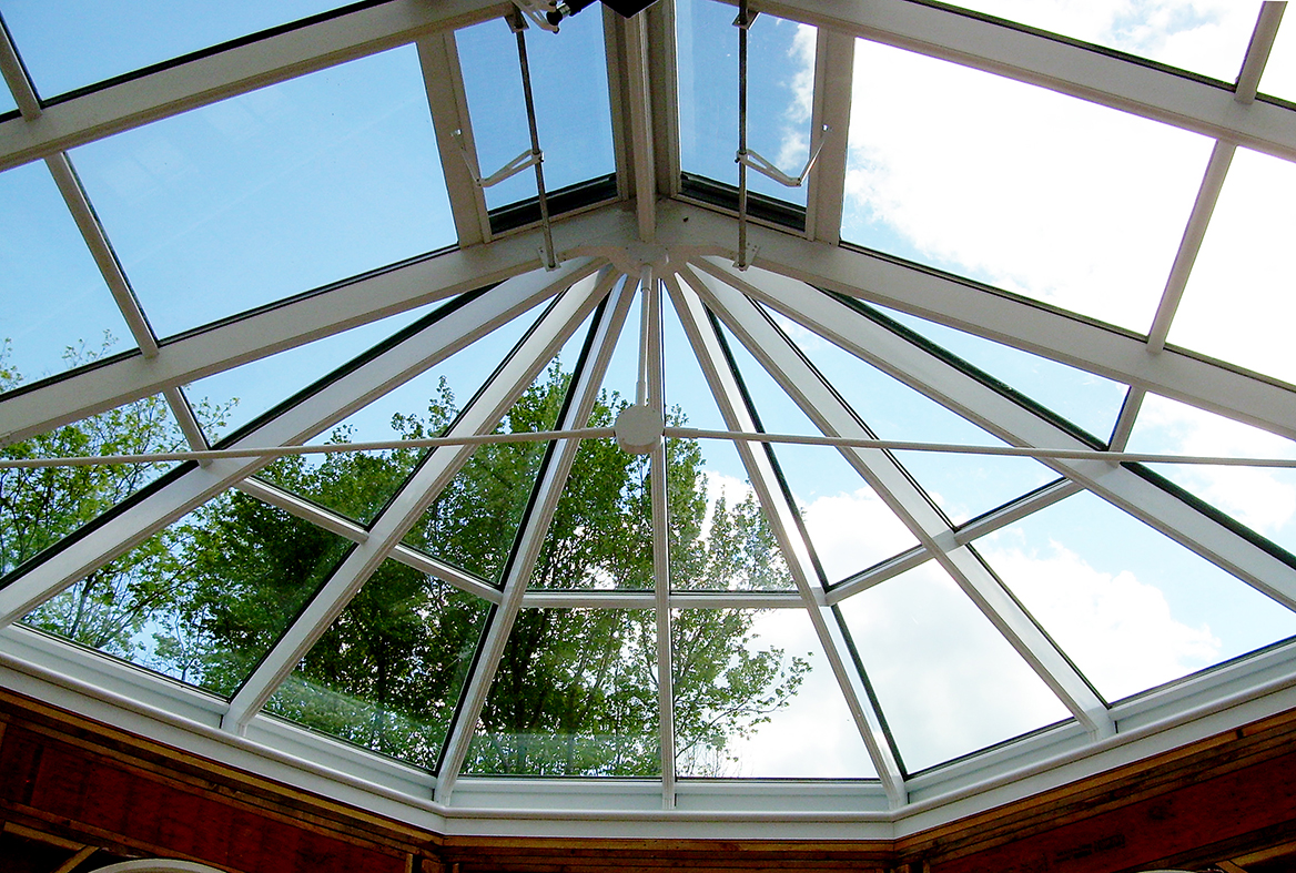 Straight eave double pitch bullnose end skylight with a rainbow in the photo