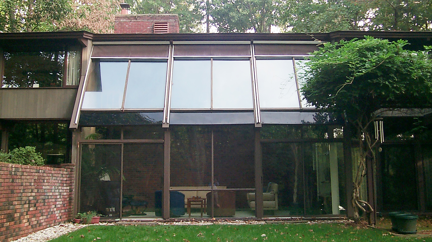 Straight eave lean-to sunroom with no gable ends, retractable exterior screens, mahongany interior, and sliding doors.Straight eave lean-to sunroom with no gable ends, retractable exterior screens, mahongany interior, and sliding doors.