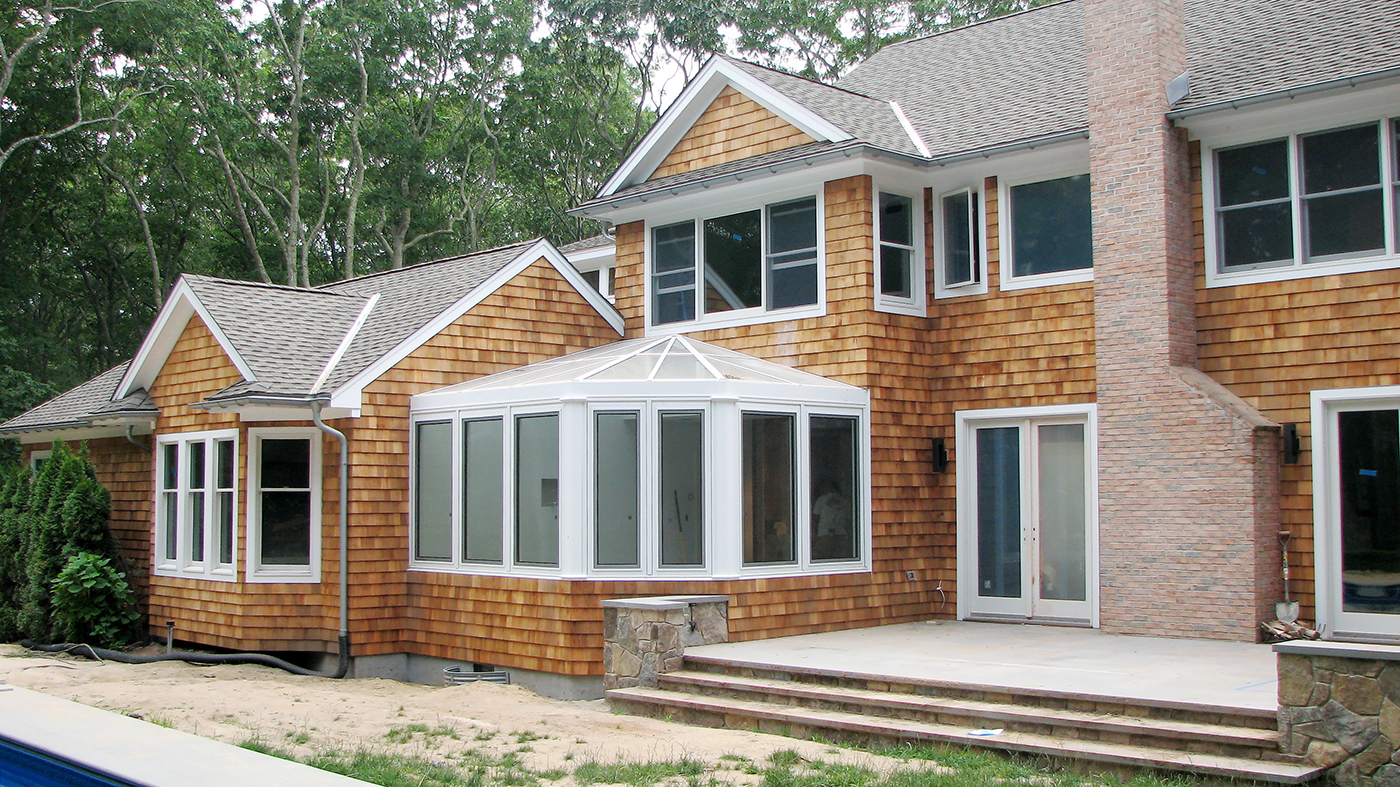 An irregular conservatory nose sunroom with seven tilt turn windows, and four decorative pilasters.