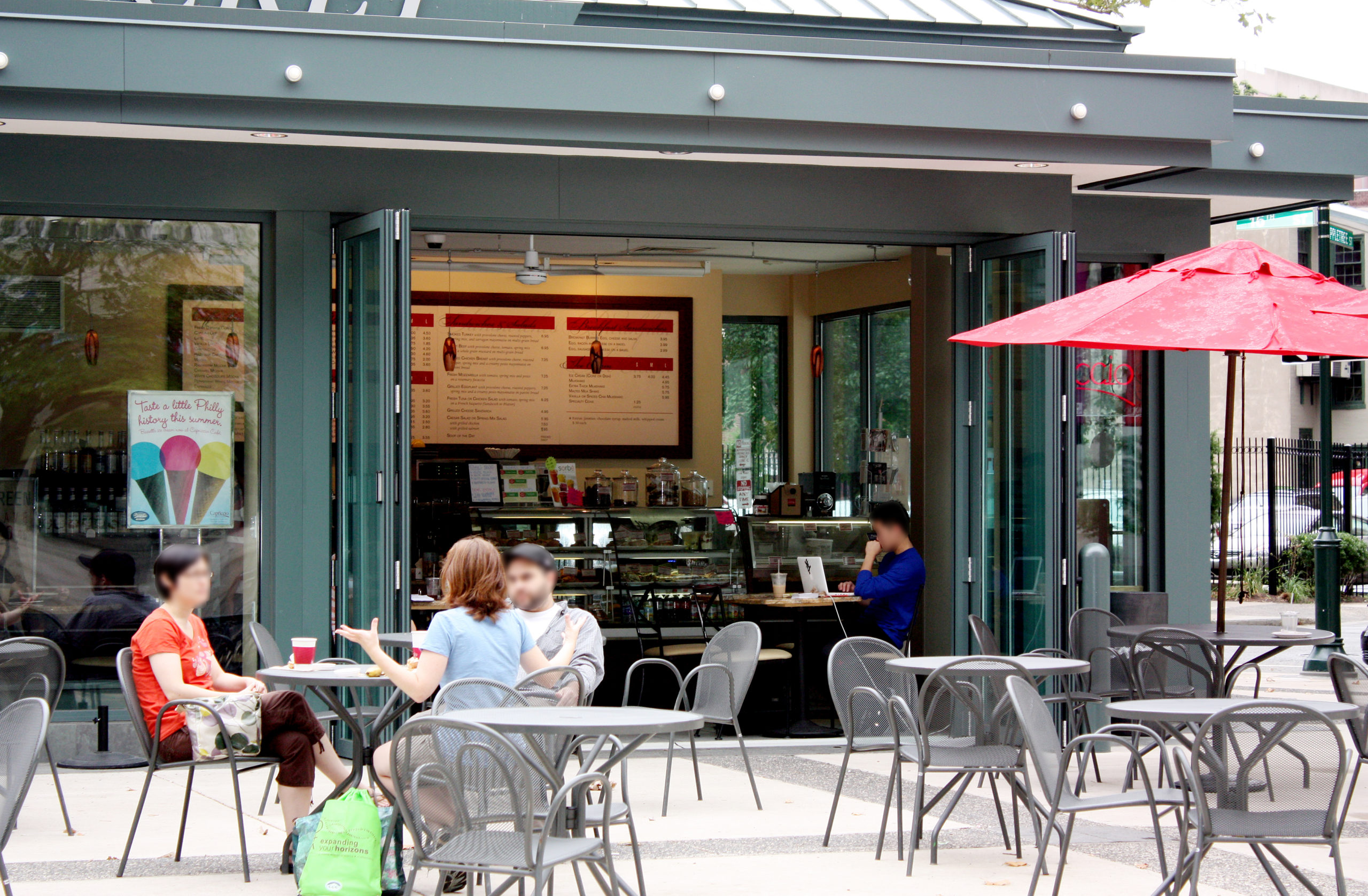 Two folding wall systems used at a cafe. Each unit has an all wall configuration, four panels that fold out and a recessed sill