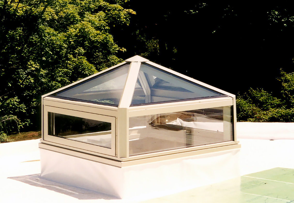 Pyramid skylight with awing windows integrated into the transom.