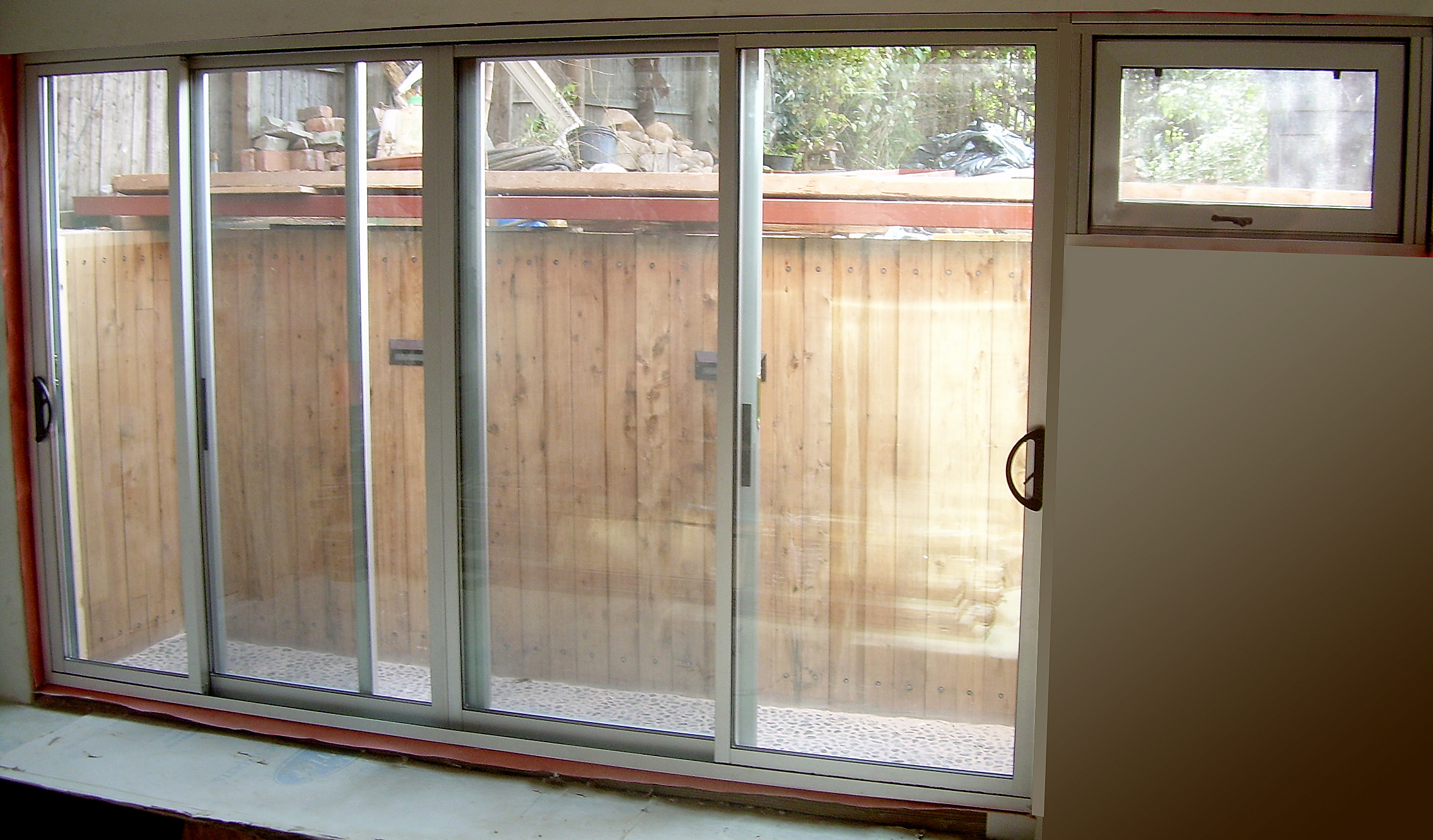 Bifold and sliding glass doors with hopper windows
