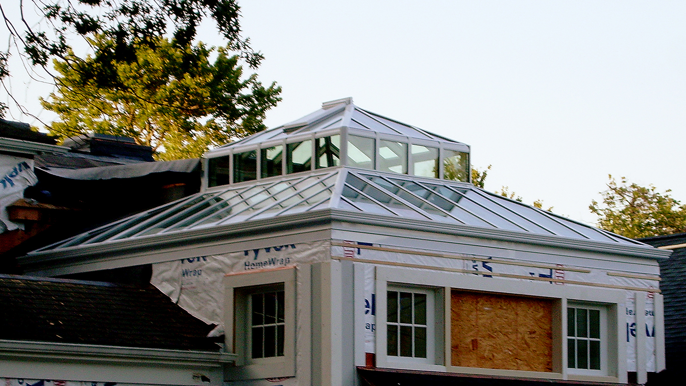 Straight eave double pitch hip end skylight with a lantern.
