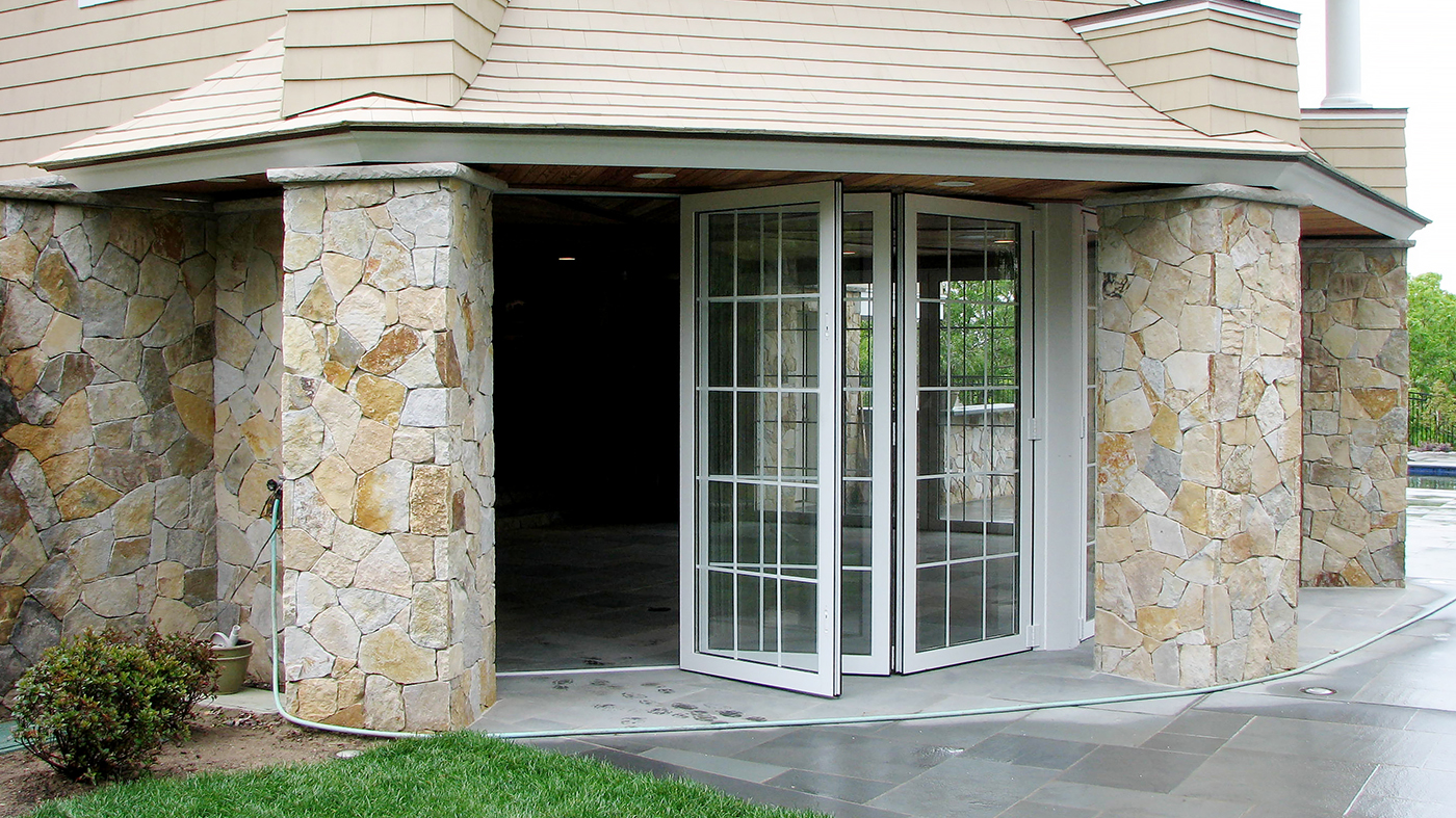 five all wall folding door systems with panels that fold to the interior which feature interior muntin gridwork, and a recessed sill with flush stop