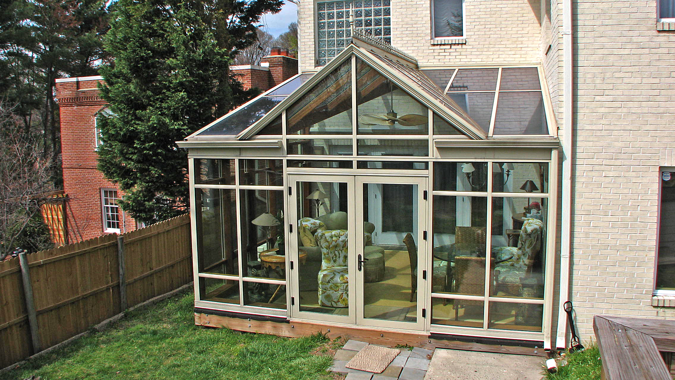 Straight eave lean-to conservatory with mahogany interior veneer.