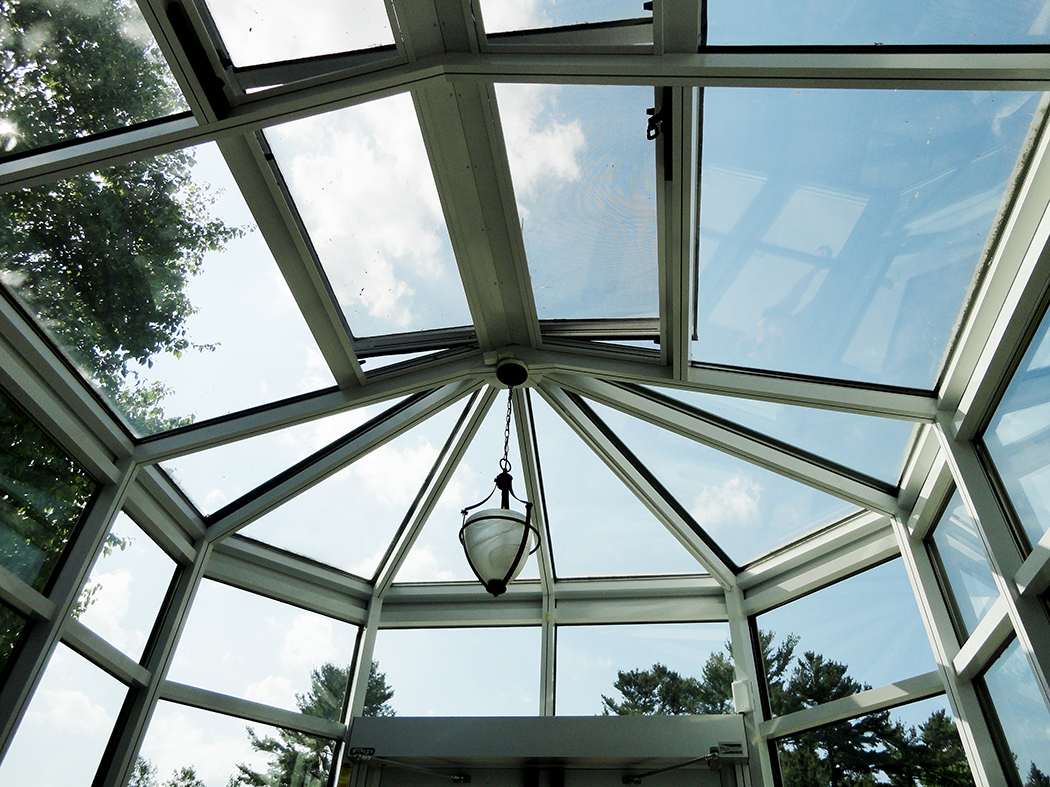 Irregular straight, eave double pitch conservatory with one conservatory nose, finial, and ridge cresting