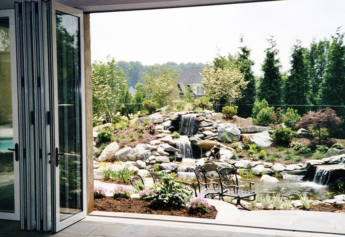 Double Door (mid wall), Bottom Load, Fold In, 5 Panels Fold Left, 5 Panels Fold Right, Standard Sill, and Sill Cover Plate residential Folding Glass Wall.