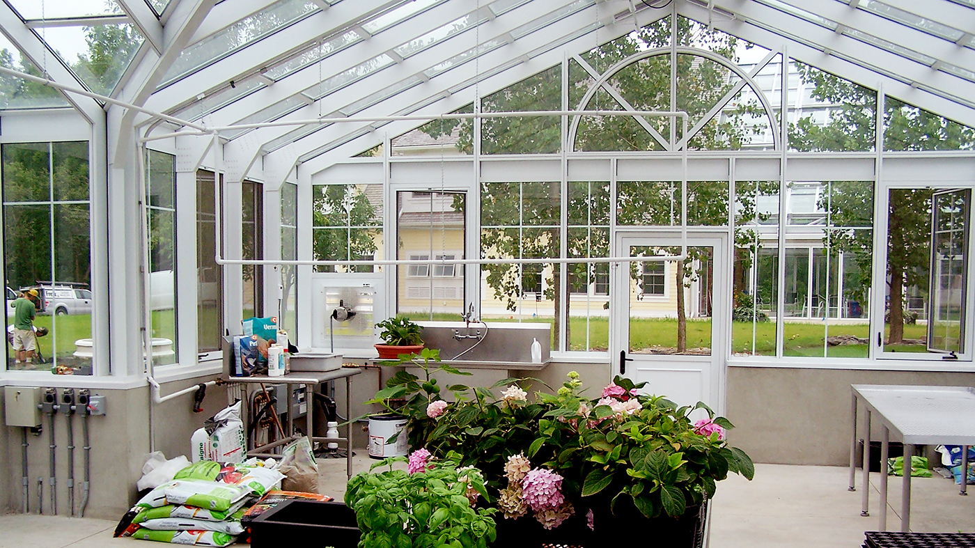 Straight Eave Double Pitch greenhouse with two gable ends, dormer and cupola.