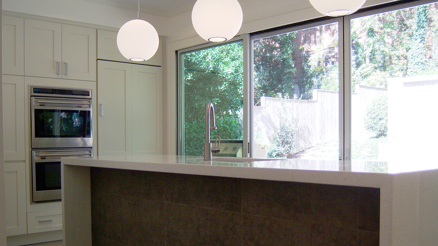 Screens on a dual track sliding glass door system.