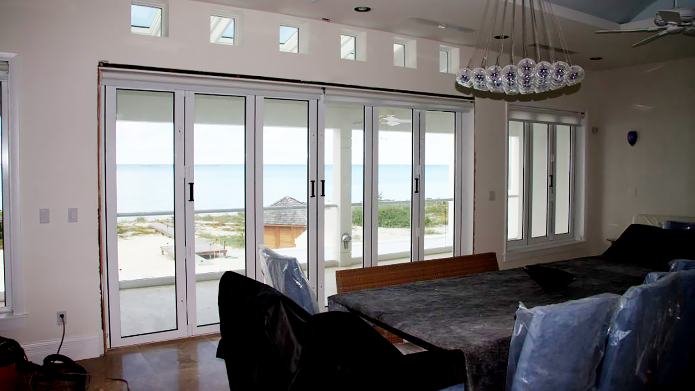 Multiple sets of folding doors and folding windows used on a residential home. Configurations include split wall, all wall, and single door hinge jamb. All units use a standard sill.