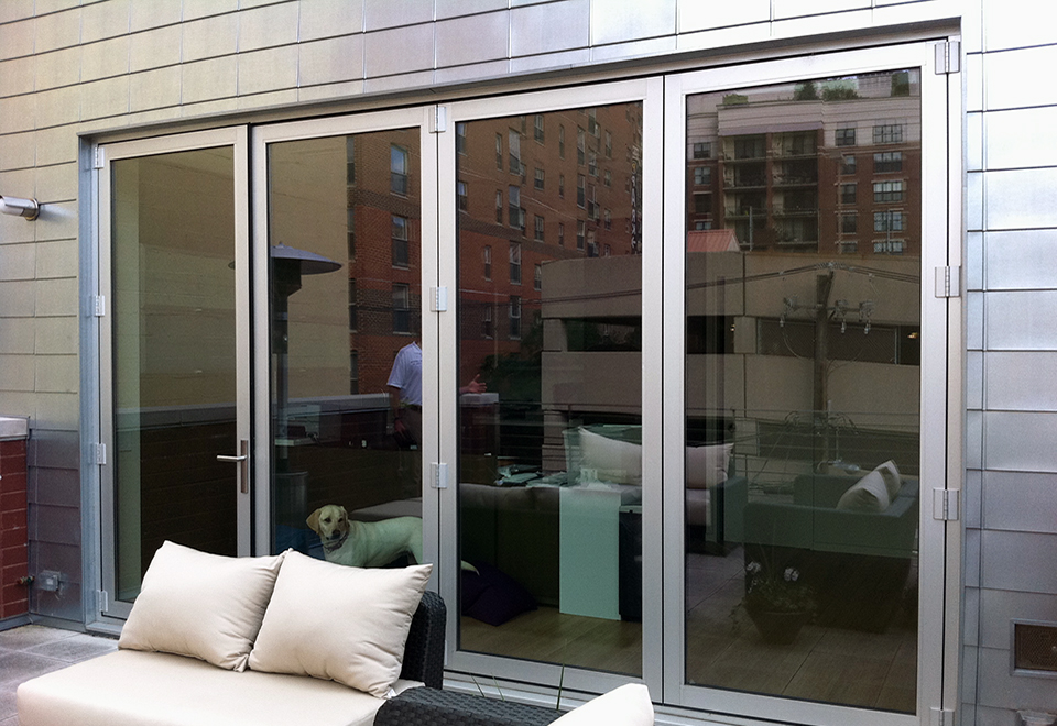 Folding glass wall system with single door hinge jamb configuration.v
