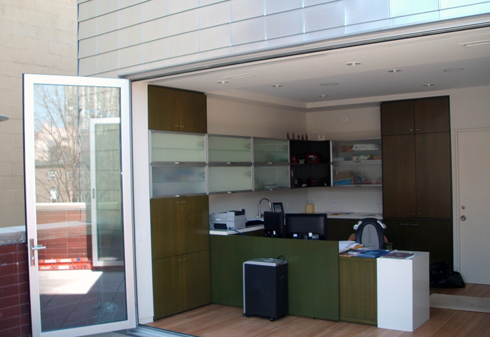 Folding glass wall system with single door hinge jamb configuration.