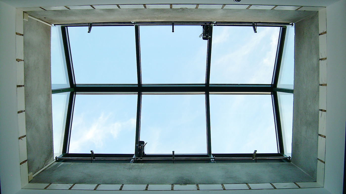 Three skylights including two straight eave lean-to configurations and one straight eave double pitch transom with eave vents.