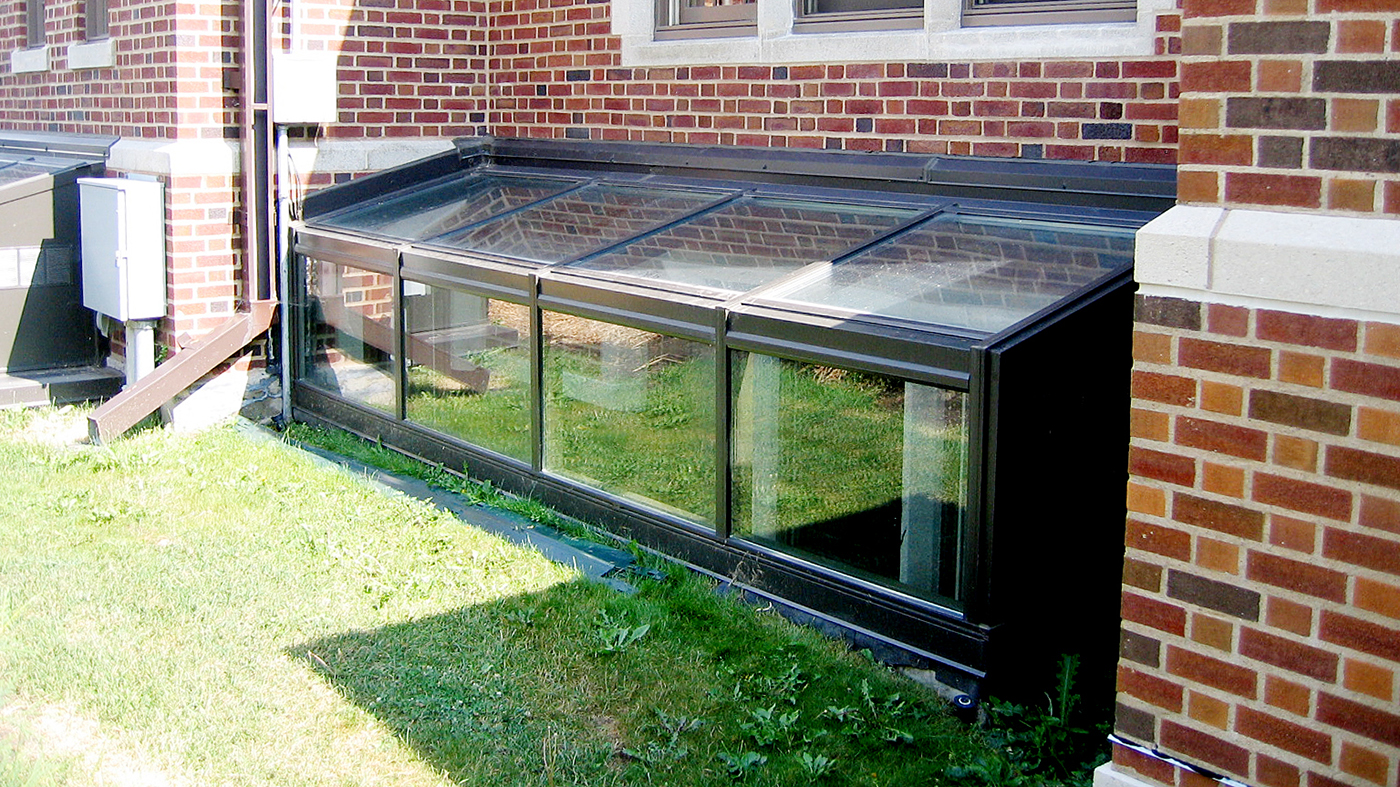 Two straight eave lean to skylights